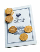 Passbook with coins — Stock Photo