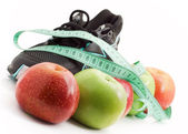 Sports and fruit diet, running shoes — Stock Photo