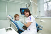 The little boy on reception at the stomatologist. — Stock Photo