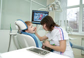 The stomatologist examines teeth of the little boy. — Stock Photo