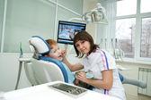 The stomatologist examines teeth of the little boy. — Stock Photo