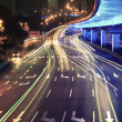 Circular viaduct road rainbow light trails night scene — Stock Photo