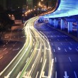 Circular viaduct road rainbow light trails night scene — Stock Photo #10050874