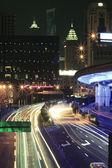 Modern office building rainbow ray background night in Shanghai — Стоковое фото