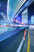 Megacity Highway at rainbow night with light trails in shanghai — Stock Photo