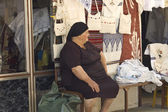 Old lady shopkeeper — Stock Photo