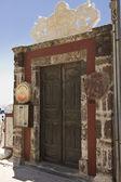 Wooden and grungy restaurant door — Stock Photo