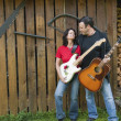 Stock Photo: Mature Couple Guitarists