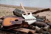 Two guitars on the beach — Stock Photo