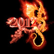 Stock Photo: Burning dragon and 2012 year isolated
