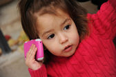 Little girl with a cell phone — Stock Photo