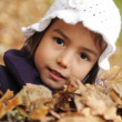 Girl playing with leaves — Stock Photo #9185797