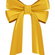 Golden satin ribbon. - Stock Photo