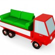 Red truck with a green sofa in a carbody. — Stock Photo #8432454