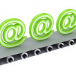 Green email signs on grey conveyor. — Stock Photo #8434435