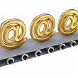 Stock Photo: Golden email signs on grey conveyor