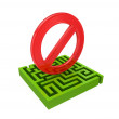 Green labyrinth and red Stop sign. - Stock Photo