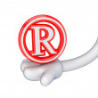 Red copyright symbol in a cartoon hand. — Stock Photo