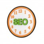 Orange watch and green word SEO. — Stock Photo