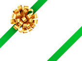 Golden bow with green ribbon. — Stock Photo