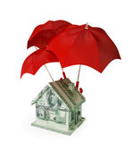 House made of money under three red umbrellas. — Stock Photo