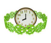 Green gears around a clock. — Stock Photo