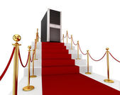 Red carpet on a stairs and PC tower. — Stock Photo