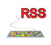 Colorful PC keyboard and big red word RSS. — Stock Photo