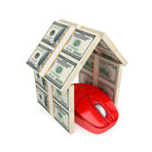 PC mouse under the roof made of dollars. — Stock Photo
