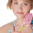 Portrait of a young woman with flower — Stock Photo