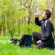 yclist Quenches the Thirst of Drinking Water on a sunny day - Stock Photo