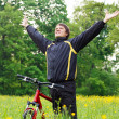 Excited happy man among the green nature with hands outstretched — Stock Photo #10478127