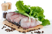 Fillet of fresh raw fish carp on a board with herbs and spices — Stock Photo