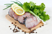 Fillet of fresh raw fish with herbs, lemon and spicy peppers — Stock Photo