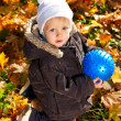 Cute child played with a blue ball in his hands — Stock Photo