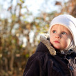 Cute child looks upward directed — Stock Photo