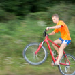 Foto Stock: Cyclist extreme riding bicycle. image is not in focus