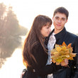 Young beautiful happy couple in love outdoor backlit — Stock Photo
