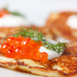 Potato pancakes with red caviar — Stock Photo