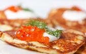Potato pancakes with red caviar — Stock Photo