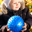 Happy smiling child with blue ball in his hands — Stock Photo