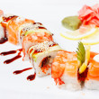 Sushi Roll with salmon, eel, tiger shrimp and tobiko caviar — Stock Photo #9378320