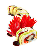 Sushi Roll with avocado, eel, tobiko caviar, sauce and sesame — Stock Photo