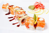 Sushi Roll with salmon, eel, tiger shrimp and tobiko caviar — Stock Photo