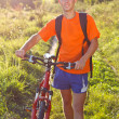 Stock Photo: Happy Man Cyclist with Bike