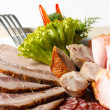 Meat sliced ​​on plate — Stock Photo #9690966