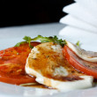 Caprese Salad - Tomatoes, Mozzarella and Arugula - Stock Photo
