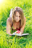 Beautiful Woman Reading Book with Apple in Hand — Stock Photo