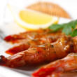 Baked Tiger Shrimps with Greens and Lemon - Stock Photo
