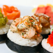 Sushi Canape with eel, shrimp, tobiko caviar, wasabi and salmon — Stock Photo #9704339